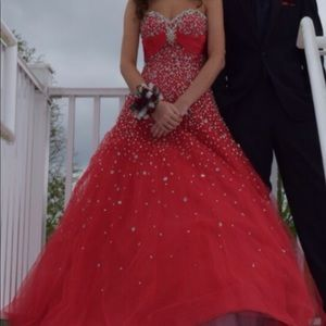 Red ball gown prom dress.
